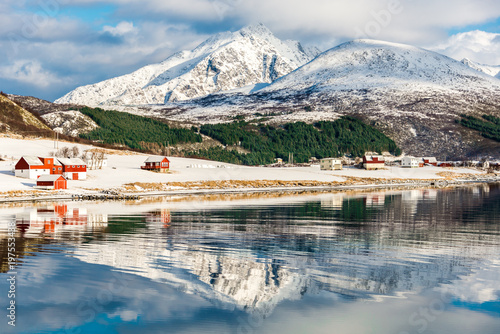 Foto auf Gartenposter Reflexion Scenery with reflected cottages and clouds in Lofoten, Norway