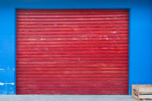 Shutter Background - Shop Exterior With Closed Red Shutter