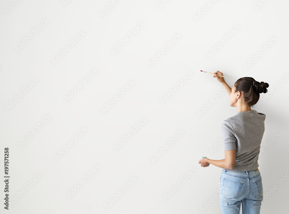 Fototapety, obrazy: Artist woman painting the wall
