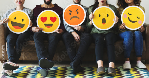 Canvas Print Group of diverse people holding emoticon icons