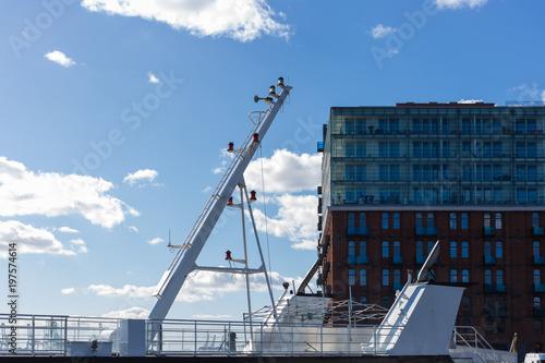 hamburg ship navigating bridge chimney fumes at docks of fishmarket  details and blue sky © rudolfgeiger