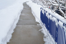 Sidewalk With Snow Removed Out...