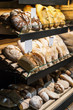 freshly baked bread and bakery products on the counter. different types of bread, buns and products