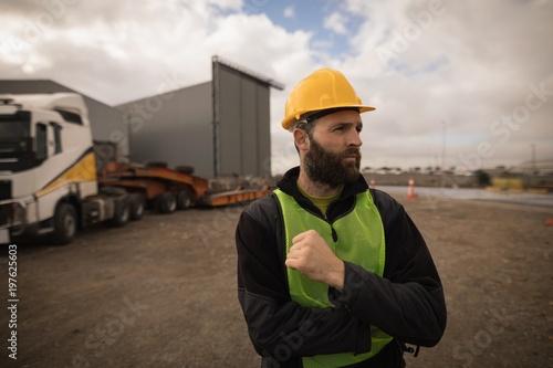 Dock worker standing in shipyard