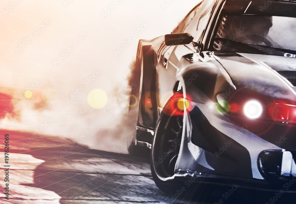 Fototapeta Blurred sport car drifting on speed track. Sport car wheel drifting and smoking with flare effect on track. Sport concept,drifting car concept.