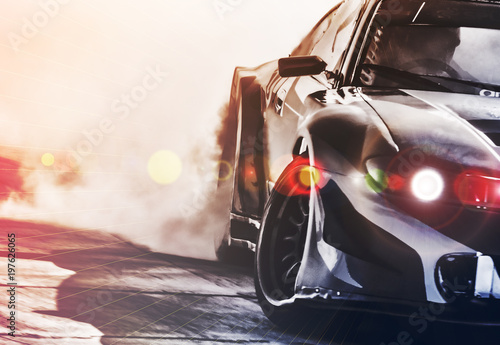 Plakat Blurred sport car drifting on speed track. Sport car wheel drifting and smoking with flare effect on track. Sport concept,drifting car concept.