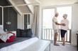 Senior Couple Arriving At Summer Vacation Rental