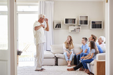 Multi Generation Family Sittin...