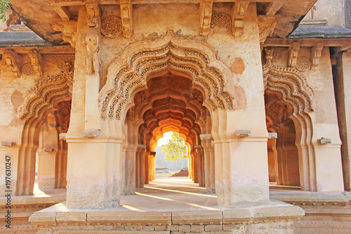 Lotus Mahal Temple in Hampi, Karnataka, India. Beautiful carved stone arch and sunset. A popular tourist route from the GOA state. Beautiful hindu temple