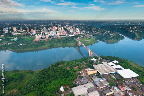 Foto op Plexiglas Zuid-Amerika land Aerial view of the Paraguayan city of Ciudad del Este and Friendship Bridge, connecting Paraguay and Brazil through the border over the Parana River.