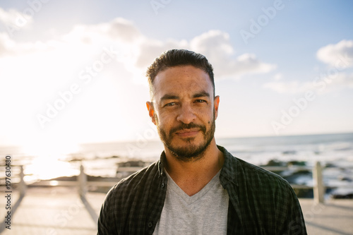 Man on vacation standing near the sea