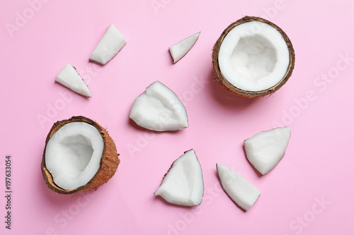 Ripe coconuts on color background, top view