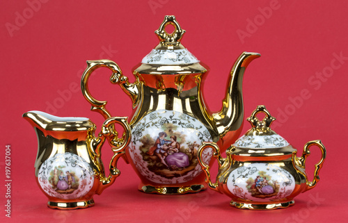Fotografie, Obraz  tea porcelain set on a red background