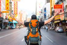 Backpacker Man Raising His Arm...