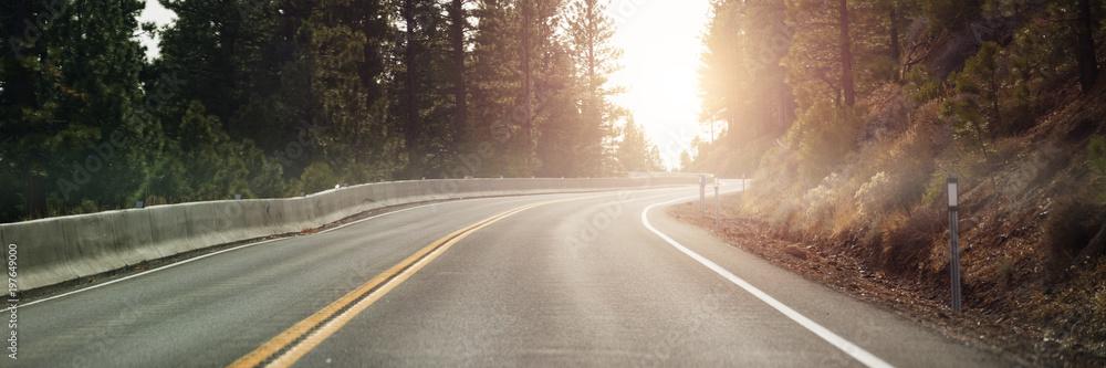 Fototapeta Mountain road through forest