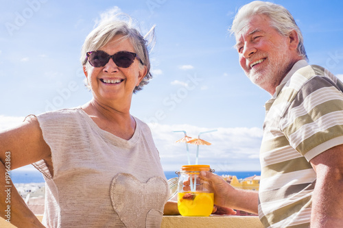 Fotografie, Obraz  SENIOR COUPLE DRINKING in terrace rooftop