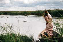 Couple Looking At Swans