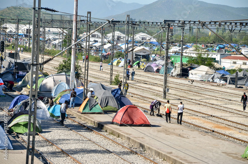 Fotografie, Obraz Idomeni, Greece, April 15, 2016 - Hundreds of migrants and refugees are camping at the Greek-Macedonian border