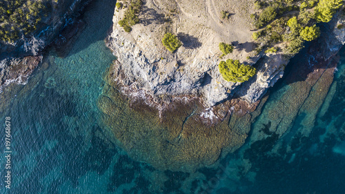High angle scenic view of sea by rocky coastline