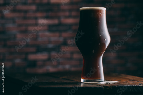 Staande foto Bier / Cider Stout beer in glass on dark background