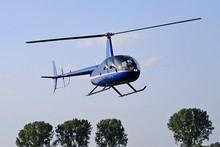 Helicopter Flying In The Blue ...