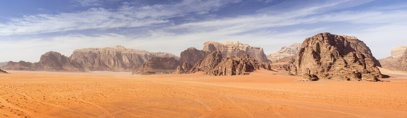 panoramic view to red sand desert with mountains rocks in Jordan