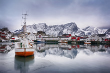 Beautiful Winter Landscape Of Harbor With Fishing Boat And Traditional Norwegian Rorbus
