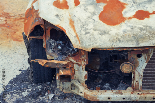 Photo  Burned car parked