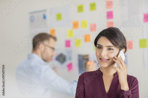 Businesswoman in office on the phone