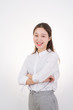 Smiling Asian Business Woman. Businesswoman in white shirt smiling looking at camera.