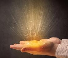 Hand Holding Yellow Light