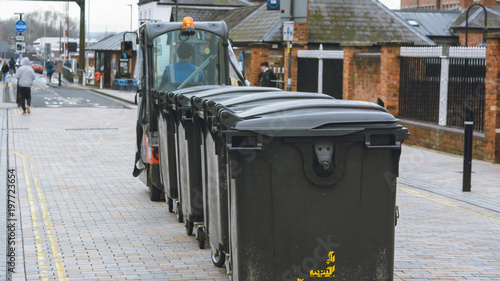 Fényképezés  Rear view of electric vehicle towing waste bins at Gloucester Quays, England sha