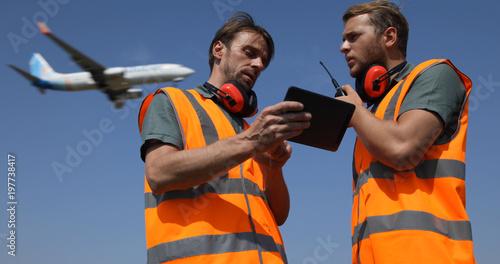 Airport Team Activity, Men Work on Digital Tablet, Talk on Walkie Talkie Collabo Canvas Print