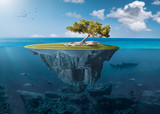 Idyllic small island with lone tree deep in the ocean