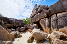 Women Is Sitting On A Rock On The Beach Of A Tropical Island, Curieuse Island, Excursion Day, Adventure Episod