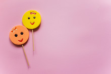 Round Smiling Lollipops Peach And Yellow Color