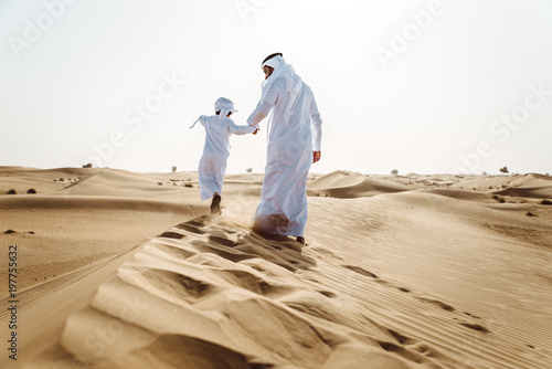 plakat father and son spending time in the desert