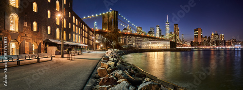 Brooklyn Bridge Park waterfront in evening with view of skyscrapers of Lower Manhattan and the Brooklyn Bridge. Brooklyn, Manhattan, New York City