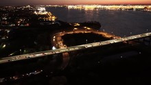 Aerial View Of Newark Bay Bridge In New Jersey At Night With Staten Island In Background