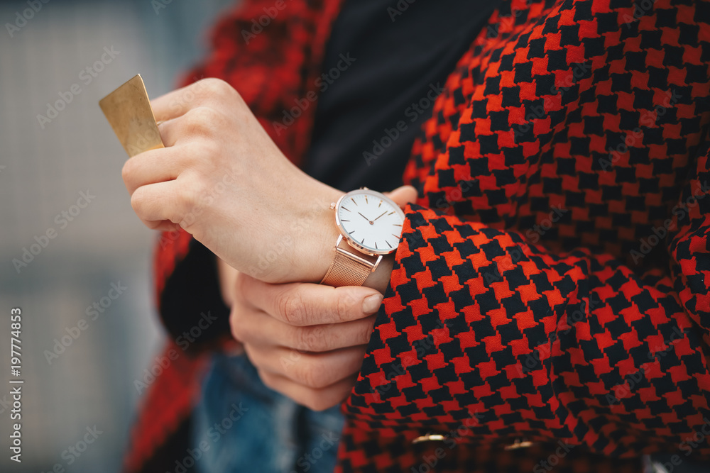 Photo  outfit details, chic woman wearing a stylish red pepita pattern jacket and a rose gold watch