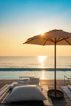 Beautiful Luxury Swimming Pool On Sea View And Umbrella And Chair In Hotel Resort With Sunrise