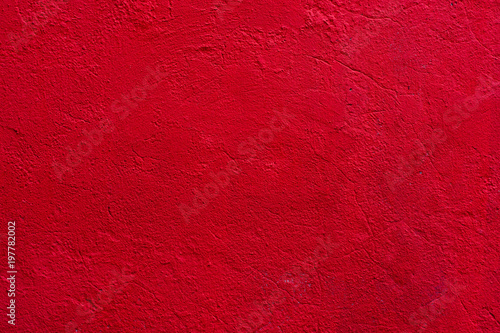 Background of a red stucco coated and painted exterior, rough cast of cement and concrete wall texture, decorative coating - 197782002