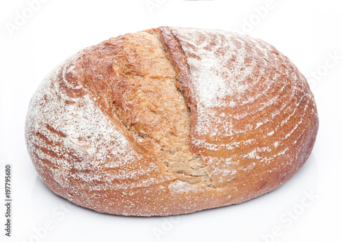 Tuinposter Bakkerij Freshly baked loaf of bread with flour on white