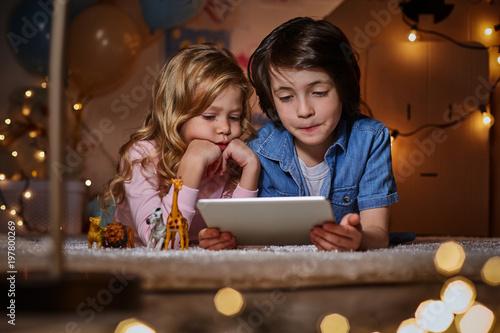 Fotografie, Obraz  Children keen on watching cartoons