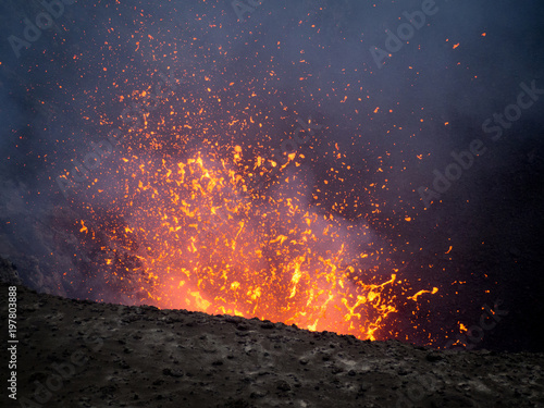 Fotografie, Obraz  Watching an Erupting Volcano with the Sunset whilst Lava Explodes in Vanuatu, Mt