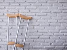 Crutch On The White Brick Wall