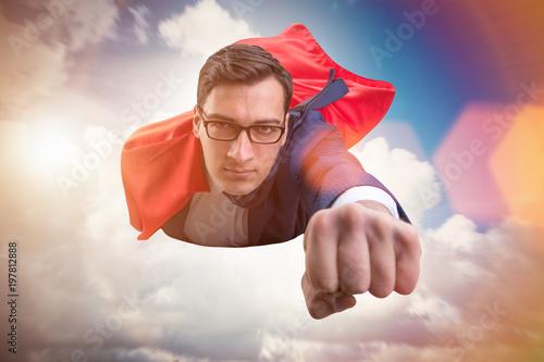 Fotografie, Obraz  Flying super hero over the city