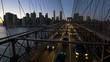 Cars driving on Brooklyn Bridge at dusk