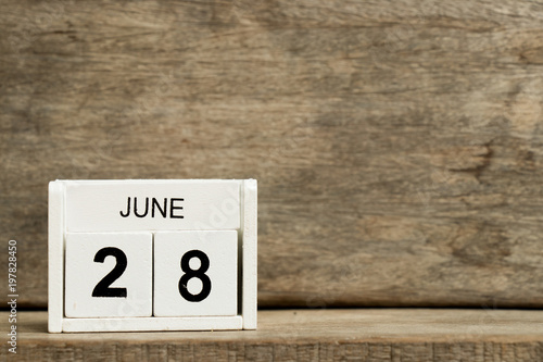 Fotografie, Tablou  White block calendar present date 28 and month June on wood background