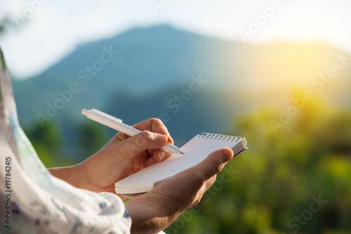 Fotografija  Hand writing on note pad